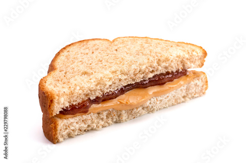 Vászonkép A Classic Peanut Butter and Strawberry Jelly Sandwich on Wheat Bread
