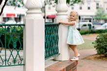 Girl Standing On A Gazebo