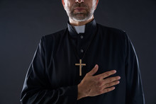 Priest Hand In Heart Gesture W...