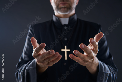 Fotografie, Obraz Priest open hands arms praying
