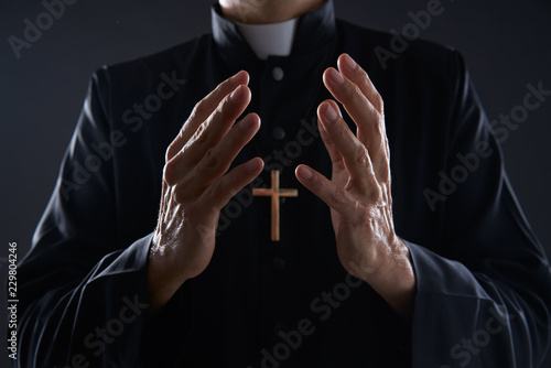 Fototapeta Priest open hands arms praying