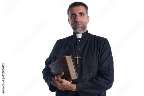Fototapeta Priest portrait with Holy Bible in hands