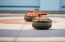 Two Granite Curling Rocks On T...