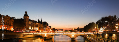 Photo sur Toile Paris Panorama of Conciergerie and Illuminated bridge Pont au Change at night, Paris.