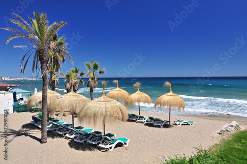 Foto  Beach in the popular resort of Marbella in Spain, Costa del Sol, Andalucia region, Malaga province