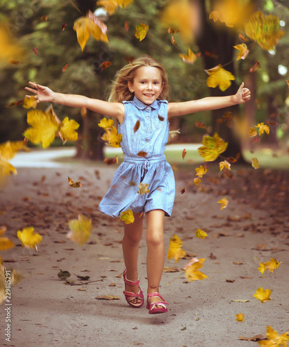 Acrylic Prints Artist KB Cheerful little girl in an autumn colorful park