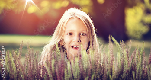 Acrylic Prints Artist KB Cute little girl hiding behind heather flowers