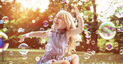 Acrylic Prints Artist KB Little blond girl among lots of flying bubbles