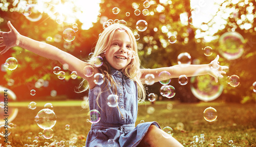 Acrylic Prints Artist KB Cute little girl playing soap bubbles