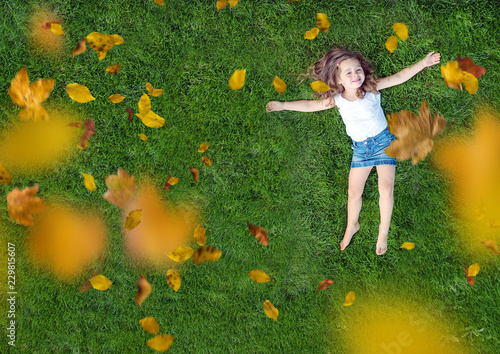 Acrylic Prints Artist KB Relaxed little girl lying on a fresh, green lawn