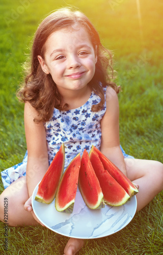 Acrylic Prints Artist KB Portrait of smiling girl holding watermelon slices in the garden