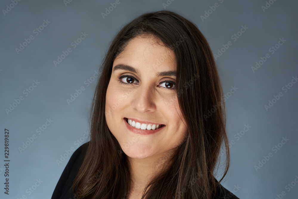 Fototapeta Headshot of young brunette woman