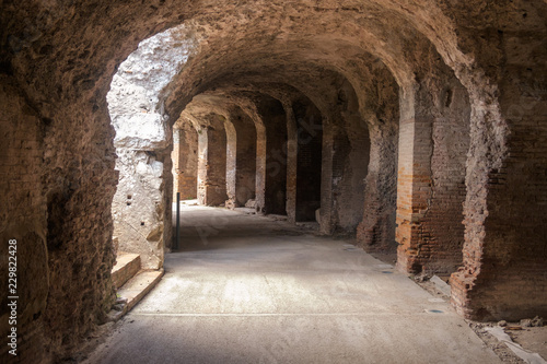 Spoed Foto op Canvas Oude gebouw To let your imagination go, it is nice to walk in the arched area around the Amphitheatre of Capua in the Italian region of Campania.