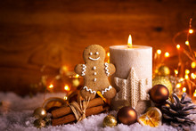 Christmas Background  -  Decorated Candle Light, Gingerbread Man And Spices