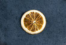 Dried Sliced Orange On Dark Texture Surface. Top View. Close Up.