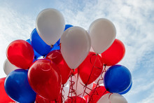 Many White, Blue, Red Balloons
