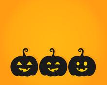 Three Happy Halloween Pumpkin Lanterns On Orange Backgrop
