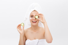 Beautiful Woman Holding Slices Of Cucumber In Front Of Her Eyes