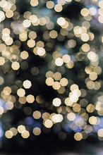 Blurry, Golden, Illuminated Christmas Fairy Lights On Outdoor Xmas Tree At The Nuremberg Christkindles Market In Winter Creating A Beautiful Out Of Focus Bokeh Effekt.