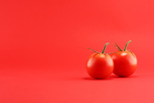 Tomato On Red Background. Italian Healthy Vegan Food Concept With Tomatoes.