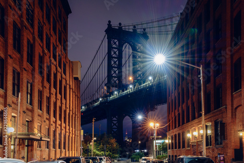 Canvas Prints Narrow alley Brooklyn bridge seen from a narrow alley enclosed by two brick buildings at dusk, NYC USA