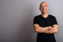 Happy Bald Man Smiling And Laughing With Arms Crossed