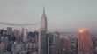 ARIAL: Flight towards Empire State Building at dusk 4K
