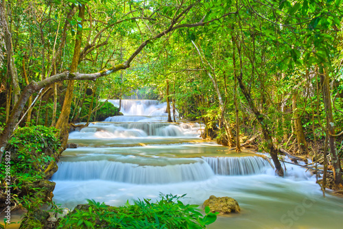 Photo Stands Forest river Huai Mae Khamin waterfall at Kanchanaburi , Thailand , beautiful waterfall, forest,