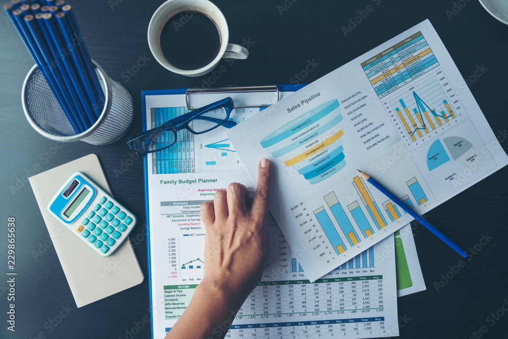 Fototapeta Excel Spreadsheet stats graph analytics data. Accountant hands holding Financial Document Trading Information with excel file. Finance statistic report analyze business graph, chart,database,report.