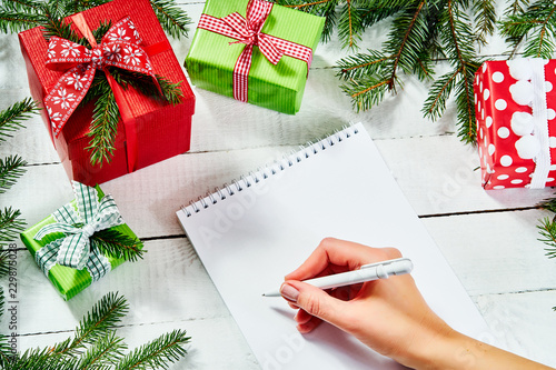 Foto op Plexiglas Tulp hand of a woman writing a letter to santa on an old white wooden table with christmas decorations