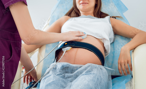 Valokuvatapetti Pregnant woman with electrocardiograph check up for her baby