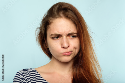 displeased capricious moody huffy girl with pursed lips Fototapet