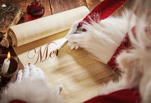Santa Claus Writing A Christmas Greeting