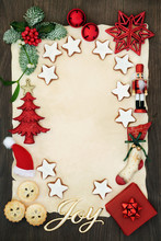 Christmas Invitation Or Letter To Father Christmas Concept With Joy Sign, Decorations, Mince Pies, Gingerbread Cookies And Winter Flora On Parchment On Rustic Oak Background.