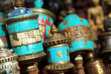 Close Up Of Prayer Wheels In Tibetan Monastery