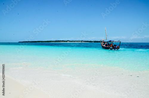 Boat on the ocean blue sea paradise island view - fototapety na wymiar
