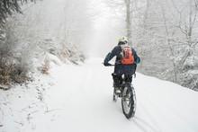 Man Riding With Electric Bicyc...