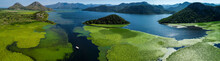 Aerial Panoramic View Of The Beautiful Landscape Of Lake Skadar In The Mountain On A Sunny Day. Montenegro. The Territory Of Lake Skadar Overgrown With Plants.