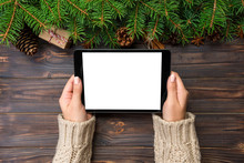 Woman Hands Using Tablet Computer On Wooden Table Bachground. Cristmas Shopping Time. Happy Christmas Mock Up Background, Top View