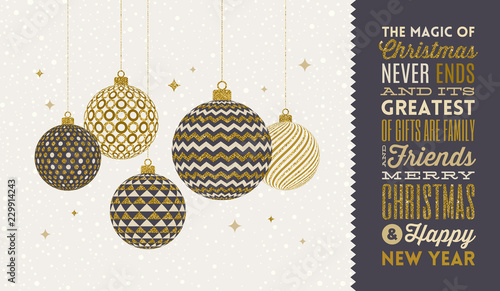 Fotografía  Christmas greeting card - patterned golden baubles on a snowy white background and type design greeting