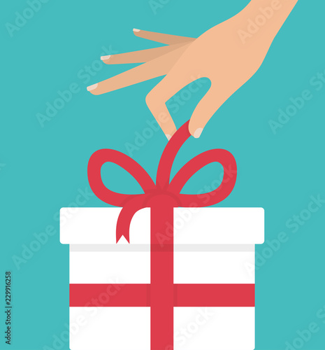 Woman's hand unpacking or unwrapping white gift box with red bow Wallpaper Mural