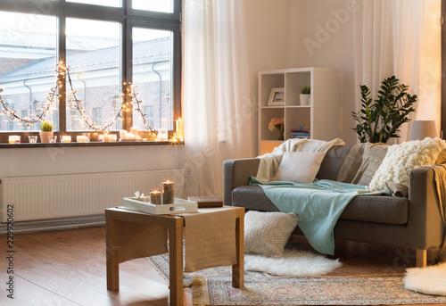 Obraz na plátně interior, christmas and interior concept - cushioned sofa, coffee table, garland