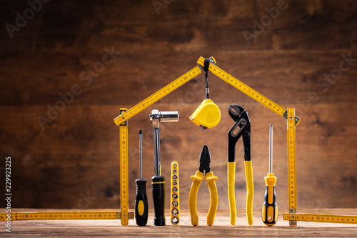House Made Up Of Measuring Tape Over Tools Fototapete