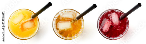 Obraz na plátně glass of fresh orange apple and cranberry juice isolated on white, from above