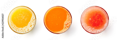 Foto auf Leinwand Saft Fresh orange carrot and grapefruit juices isolated on white, from above
