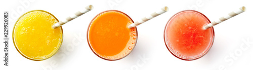 Fresh orange carrot and grapefruit juices isolated on white, from above Wallpaper Mural