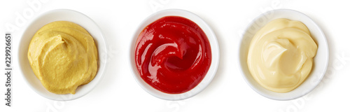 Fotografia Ketchup mayonnaise and mustard isolated on white, from above