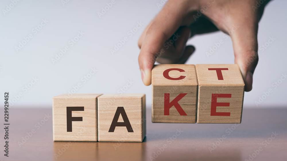 Fototapeta Fact or Fake concept, change wooden cube