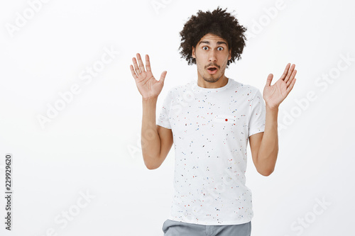 Canvas Prints Palm tree Excited and emotive handsome male describing huge boom happened on street. Portrait of good-looking surprised and shook hispanic man with moustache gesturing with raised palms while talking
