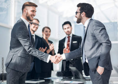 Fényképezés  handshake of business people in a modern office
